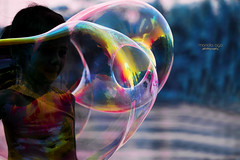 blowing illusions away ... (mariola aga) Tags: girl blowing illusions soap bubbles reflections hue art
