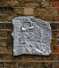 Tagging Dinosaurs (Steve Taylor (Photography)) Tags: aerosol can rnzo cast silver dinosaur spray skateboard cctv camera art graffiti streetart wall brown brick uk gb england greatbritain unitedkingdom london
