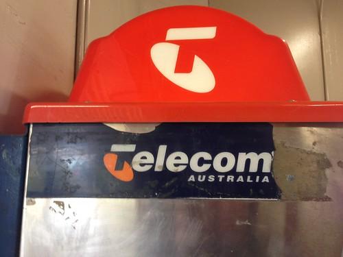 Telecom Australia logo on phone booth in Hawksburn Railway Station