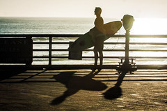 Oceanside Pier (EthnoScape) Tags: oceanside california surfer surfers surfing surfboard surfboards surfista surfistas oceansidepier pier boardshorts swimwear silhouette sun beach shadow shadows athlete athletic fit fitness diet health nutrition sport gym binoculars telescope fiberglass fin fins shape shaper shaped coast ethnoscape ethnoscapeimagery