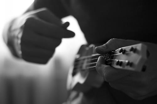 Playing mini ukulele