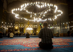 Muslim men praying inside new mosque Yeni Camii, Marmara Region, istanbul, Turkey (Eric Lafforgue) Tags: adultsonly ancient architectural architecture byzantine byzantium carpet ceiling chandelier constantinople europe exterior holy horizontal illuminated indoors interior islam islamic istambul istanbul lamps landmark menonly minaret monument mosque muslim oriental ottoman religion religious structure style sultanahmetcamii sultanahmet tourism tourist travel turkey turkey882 turkish marmararegion