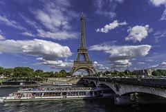 Paris (emilqazi) Tags: eiffel tower paris france river seine city cityscape bridge clouds boat travel tour sky
