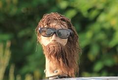 Jesus Superstar (Moon Rhythm) Tags: head beard jesus sunglasses mannequin ornament driveby hair bolted dirty exposure cartop windblown