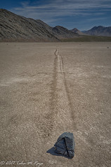 Rock and the racetrack in the playa (taharaja) Tags: cactus california deathvalley desert furnacecreek ghosttown jeeping lowestpoint nationalpark offroad oldtown racetrack sealevel zabriskiepoint lakebed movingstones slatflats unitedstates