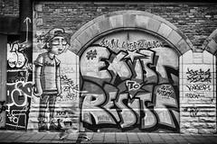 EXIST TO RESIST (Daz Smith) Tags: dazsmith fujixt20 fuji xt20 andwhite bath city streetphotography people candid portrait citylife thecity urban streets uk monochrome blancoynegro blackandwhite mono blur walker trainers mural graffiti art spray paint bristol stokescroft resist