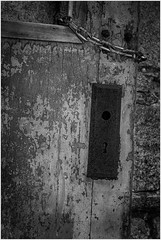 Rusted broken door (ronnymariano) Tags: wood old keyhole abandoned decay chain easternstatepenitentiary rust history key grain broken prison 2017 door builtstructure hole weathered damaged outdoors retrostyled obsolete everypixel backgrounds wallbuildingfeature blackandwhite rusty dirty house architecture oldfashioned bnw monochrome