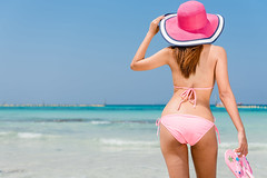 Beach vacation. Hot beautiful woman in sunhat and bikini standing with her arms raised to her head enjoying looking view of beach ocean on hot summer day. Photo from Hapuna beach, Big Island, Hawaii. (Batt Photographer Phuket) Tags: women body bikini summer tan beach back ass beachhat beautiful behind big blue bottom butt buttocks cellulite getaway girl happy hapuna hat hawaii hawaiian island lady lifestyle ocean outside people person rear relaxing resort sea sexy sky slim sun sunhat sunny sunshine tanned travel tropical usa vacation water white young