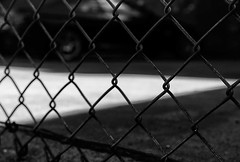 Wheels (TwinCitiesSeen) Tags: fence car lacrosse wisconsin canon6d tamron2875mm blackandwhite