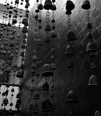 cascading bells (SM Tham) Tags: asia southeastasia indonesia bali island nusadua sofitel resort hotel interior design decorations waterfeature wall cascading water bells chains blackandwhite monochrome