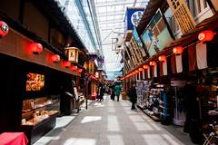 Walking back in time (Blue Nozomi) Tags: anachronistic haneda airport tokyo japan passenger shopping kaimono lantern red shitamachi