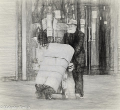 Contemplating Life's Journey (M C Smith) Tags: man trolley shops pavement sketch monochrome