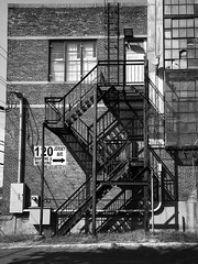 chutes and ladders (sephrocker) Tags: iphonese blac monochromatic industrial fireescape building brick factory libes contrast