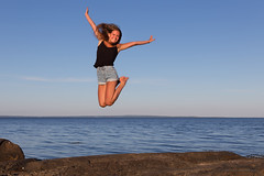 Andrea in the air (Normann Photography) Tags: andrea konfirmasjon outdoorphotoshoot tønsberg vestfold norway no lilleafrika ringshaugholmen people jump face happy emotions horizon sea blue smile intheair person girl youngwoman