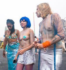 After the Parade - 1 (UrbanphotoZ) Tags: mermaidparade coneyislandmermaidparade man women marchers sarong shorts sequins bluewig pasties fishnet beads tattoo bodypaint braids shells twine coneyisland brooklyn newyorkcity newyork nyc ny