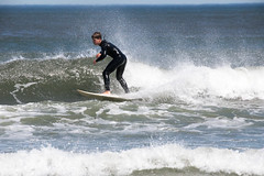 A surfer rides a wave off Manasquan Beach. (apardavila) Tags: atlanticocean jerseyshore manasquan manasquanbeach beach surf surfboard surfer waves