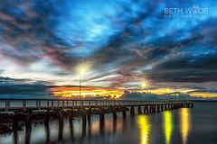First Light (Beth Wode Photography) Tags: dawn firstlight morning sunrise jetty pier wellingtonpoint redlands wellingtonpointjetty reflections sky sunrisesky clouds beth wode bethwode