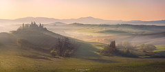 Once upon a time... (Ron Jansen - EyeSeeLight Photography) Tags: tuscany italy podere belvedere spring sunrise light morning soft mist hills roe deer graze grazing pastel colors panorama d810 color widescreen valley orcia pienza sanquirico house building cypress tree trees dawn mood fairytale nikon 70200