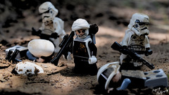 A bounty hunter drops by (RagingPhotography) Tags: d3300 lego star wars galactic empire imperial stormtrooper trooper jump packs jetpacks minifigure minifig figures toy plastic dirt outside outdoor filth dust dengar bounty hunter blasters gritty dark serious