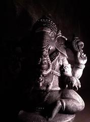 Emerging from the Shadow. Ganesha Portrait (Beato J | Royalty Free Music for Media) Tags: ganesh ganesha ganapati hindu hinduism black white ritual religion india srilanka hands elephant dark darkness yoga meditation statue idol