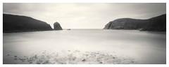 Beach with stones (bigtalljohn) Tags: zero 2000 pinhole panf harris islands sea 6x9 light leaks west tetenal