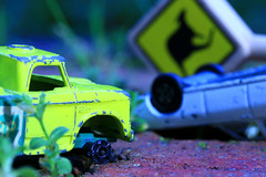 Outback bingle (alideniese) Tags: macromondays broken macromondaysbroken macro closeup car truck miniature toycars vehicles yellow red pavement pathway gardenpath roadsign bingle collision outdoors bokeh colour 7dwf