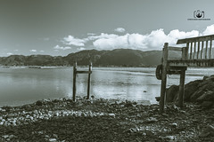 Beach Time (CFBoucher Photography) Tags: black bw white beach new zealand nz dock rocks pebbles winter summer swim hike hiking south island water buoy boating boats ships