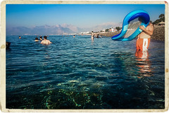 Last day of the bayram (Melissa Maples) Tags: antalya turkey türkiye asia 土耳其 apple iphone iphone6 cameraphone mediterranean sea water konyaaltızero beach blue inflatable raft turk man mountains summer border vintageborder