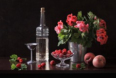 The Taste of Raspberry (Esther Spektor - Thanks for 12+millions views..) Tags: stilllife naturemorte bodrgon naturezamorta stilleben naturamorta composition creativephotography arrangement artisticphoto summer atbletop bouquet flowers geranium food fruit peach raspberry taste water bucket bottle stand goblet glass metal availablelight reflection green red scarlet grey silver oink brown black estherspektor canon