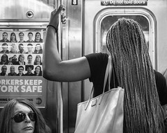 Do Not Hold Doors (John St John Photography) Tags: streetphotography candidphotography 1train mta subway train newyorkcity newyork women braids pocketbook purse sunglasses braidedhair bw blackandwhite blackwhite blackwhitephotos johnstjohn