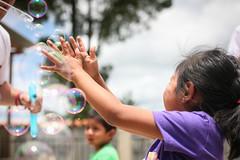 Girl Catches Bubbles (mayanfamilies) Tags: fundaciónfamiliamaya guatemala mayan families charity donate indigenous annawatts canon eos 5d preschohol bubbles fun playing