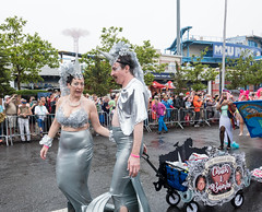 Mermaid Parade Wedding - 2 (UrbanphotoZ) Tags: mermaidparade coneyislandmermaidparade marchers costumes newlyweds justmarried chuck bambi chuckandbambi spectators coneyisland brooklyn newyorkcity newyork nyc ny veils unicorns silver wagon vest pearls theweddedbliss flowerfish parachutejump