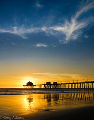 Southern California Sunset (Greg Adams Photography) Tags: huntingtonbeach surf surfcity sunset beach dusk blue gold yellow pier dock wharf clouds glow silhouette silhouettes reflections california calif southerncalifornia travel tourism serenity serene hhsc2000 colorful colors 2014