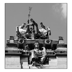 Britannia ruling, from an odd angle (A.I.D.A.N.) Tags: britannia statue statues hull humberside trident sculpture roof rooftop guild hall fujix100 fuji fujifilm fujixseries x100 building buildings blackandwhite blackwhite monochrome sky cloud lookingup viewpoint angle pointofview unusual squareformat square uncompromising stare glare horses chariot horse chariots drive driving ride riding seated british symbol rule waves symbolic guildhall law court courts woman helmeted