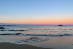 Sunset on the Coast with Island (Merrillie) Tags: sand landscape sunset nature australia mountains waves ocean newsouthwales sea southcoast sun batemansbay beach scenery seascape trees pink coastal island nsw waterscape clouds coast water snapperisland