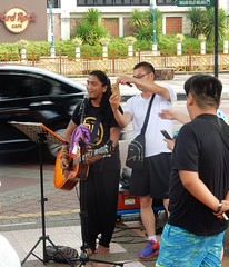 The Selfie Scourge Now Plagues Buskers (mikecogh) Tags: malacca selfie scourge rude busker invasive guitar gracious melaka