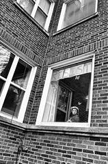 Resist (draketoulouse) Tags: chicago rogerspark people street streetphotography monochrome blackandwhite city urban window politics marchfortruth child children kid daycare