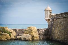 Sea Wall - Lagos (JDWCurtis) Tags: lagos sea water waterfront beachfront tower parapet castle fort portugal towercastle seawall wall bay yacht horizon algarve coast coastline rock rocks