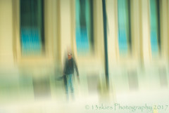 The Lonely Parade (HSS) (A2A) (13skies) Tags: parade city cambridgeon man walking guitar building blurred photoshopelements layers effect windows abstract attraction2abstraction moving 13skies motion person layermask street downtown