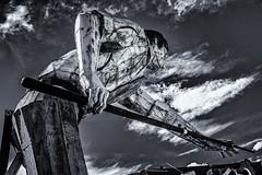 Shootin' Stick (evanffitzer) Tags: lasvegas fujix100s fujifilmx100s evanfitzer evanffitzer neonboneyard signs metal bw blackandwhite mono monochrome pool billiards statue elvis