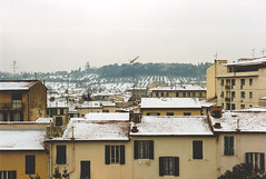 Florence with snow (John fae Fife) Tags: rooftops trees houses aerials 1980s canonae1 italy snow film florence