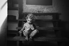 Bruised knees and curiosities (Kapuschinsky) Tags: blackandwhite monochrome fineart fineartlifestyle lifestyle candid portrait candidportrait childportrait baby curls naturallight indoors inside sonyalpha sonyphotographing minolta sonya900 steps stairs emotive moody texture sitting kapuschinsky