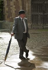 Trinity College Porter (dennylyons) Tags: cambridge porter trinitycollege bowler hat pose bowlerhat brolly