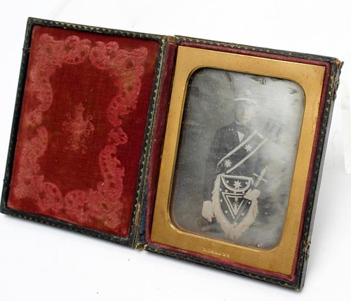 "Masonic Quarter Plate Daguerreotype ($476.00): Image of a man in Masconic regalia. Brass frame imprinted with ""M. P. Simons."" Possibly a member of the Yount family."