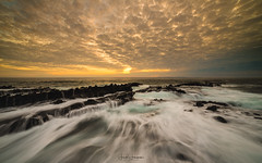 """Rushing In""~ (swazileigh/ Langman Lightscapes) Tags: lagunabeach landscape landscapephotography lagunabeachcalifornia beach beachscape beachsunset clouds rocks rockpools woodscove nikon nikond800 singhrayfilters singhray rushingwater flow tide sun yellow water horizon seascape seashore"