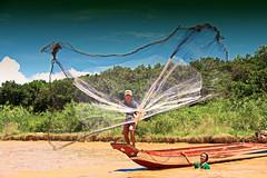 Fishing In Tonlé Sap Lake,  Siem Reap,  Cambodia (Chandana Witharanage) Tags: cambodia southeastasia siemreap tonlésaplake river rivers fish fishing travel boatride floatingvillageintonlésaplake 7dwflandscape