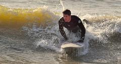 Riding the waves. (alex.vangroningen) Tags: surfer sea colors waves surfboard outdoors cold sun idiot foam somebodyishavingfun