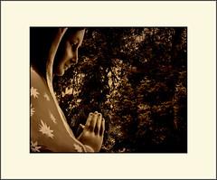 Angels visit you (Bob R.L. Evans) Tags: praying catholic hands face symbol catholicstatue ipadphotography unusual sepiatone lightshadow