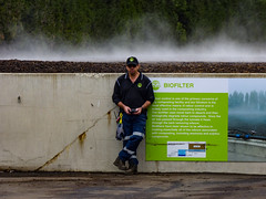 He Must Be Bio Phil (Steve Taylor (Photography)) Tags: biofilter steam heat filter green blue black brown calm concrete man workman newzealand nz southisland canterbury christchurch mist recycle centre compost