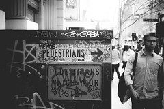 Pedestrians To The Right (Jon Cartledge) Tags: 40mm leicam people black blackandwhite bw construction finder graf graffiti iconic leica life mrokkor m9 man melbourne melbs mono monochrome pedestrians photography photos range rangefinder rokkor shot sign snap street streetphotography streetscene streetshooter streetshot streetview streets tourists travel urbanpeople urbanstreet urbanview whitebw
